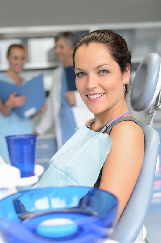 woman-patient-sitting-chair-dental-surgery-professional-dentist-team-checkup_skfhruaej